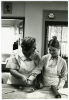 "Photograph of Star & Crescent cook Evelyn Kowalski teaching a ""Cooking with Evie"" class."
